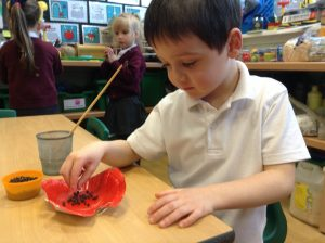Adding the finishing touches to our poppies